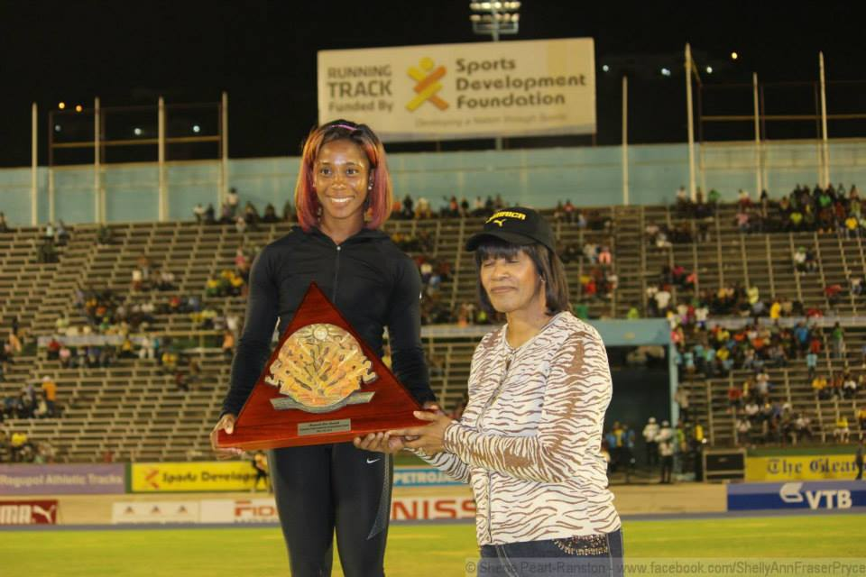 Fraser-Pryce with Jamaican Prime Minister Portia Simpson-Miller at the 2014 Jamaican Invitational Meet (c) Fraser-Pryce's Facebook page
